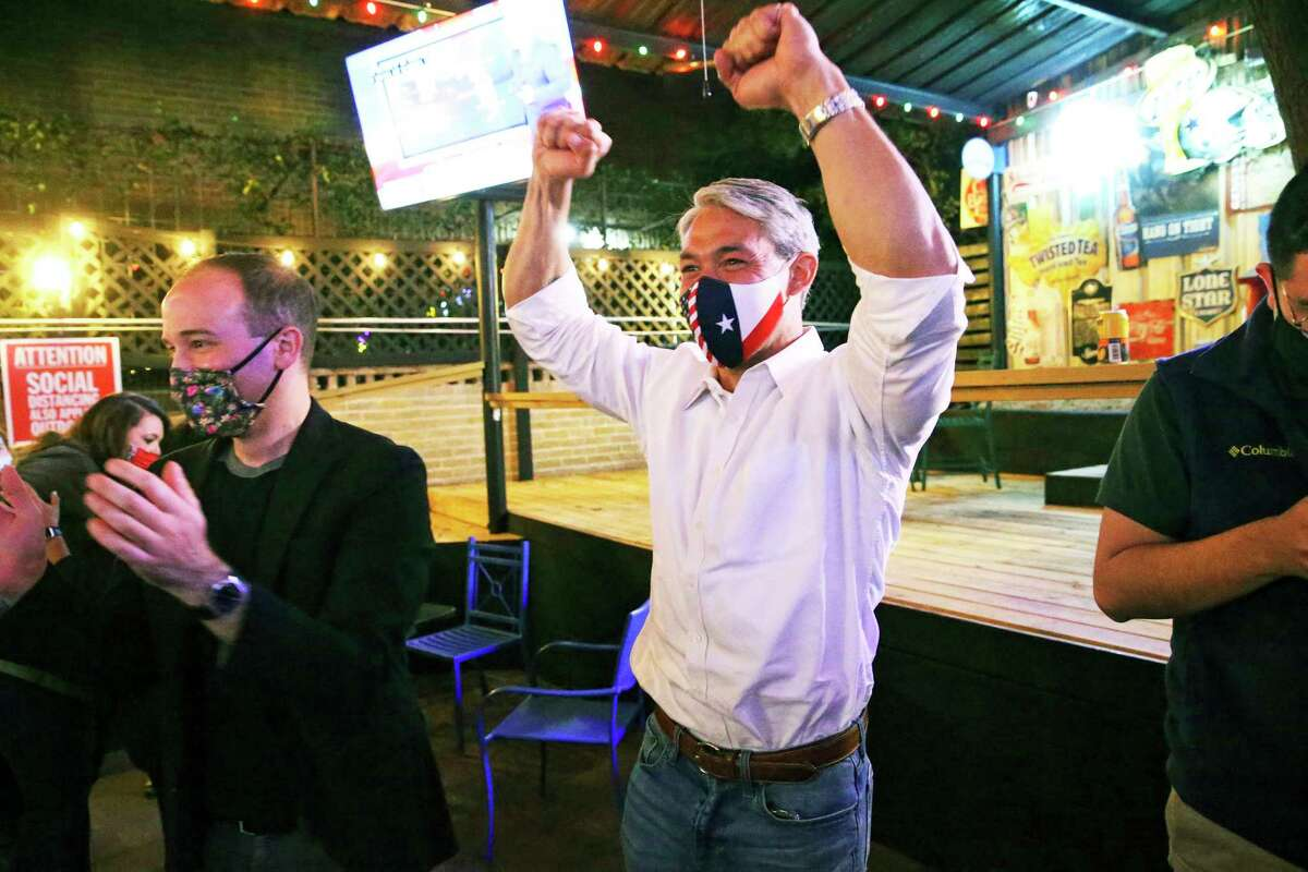 Mayor Ron Nirenberg celebrates with advisor Zach Lyke,left, as he hears very favorable results for the Ready to Work campaign at Augie's Barbed Wire Smoke House on Nov. 3, 2020.