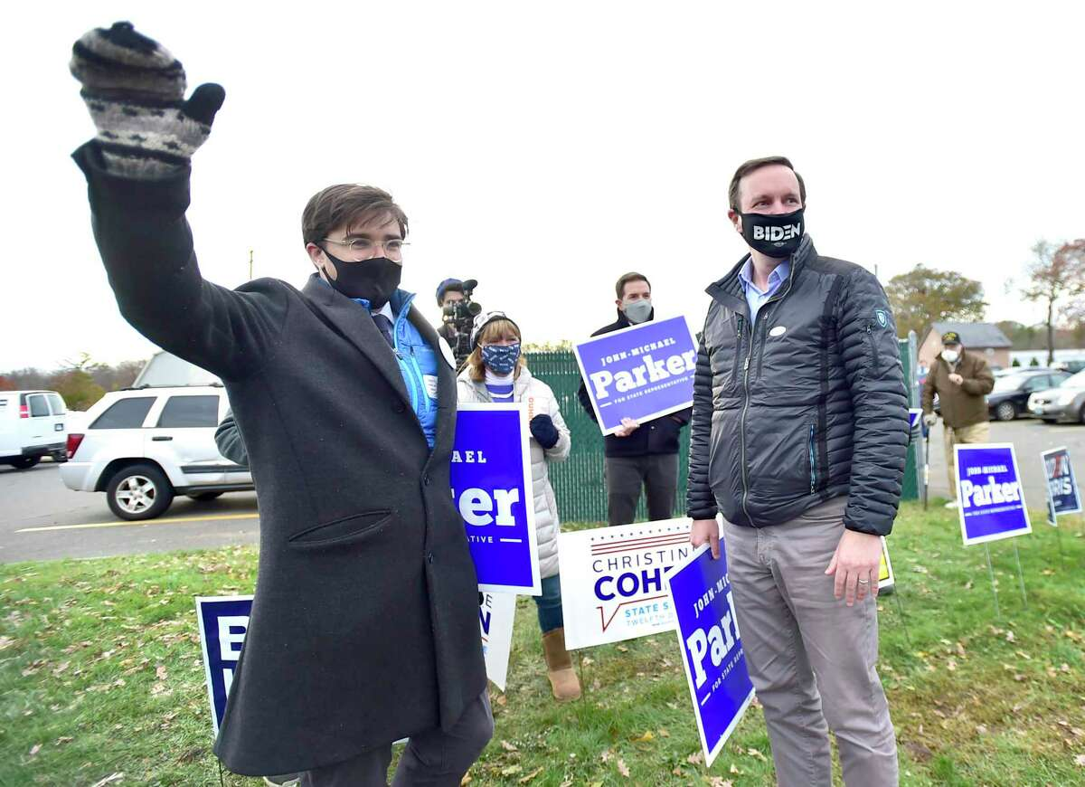Madison, Connecticut - Tuesday, November 3, 2020: John-Michael Parker, left, running for State Representative representing Madison and Durham on the Democrat, Independent and Working Family Party ticket, campaigns Tuesday at the Polson Middle School polling place in Madison as U.S. Senator Chris Murphy provides his support, right.