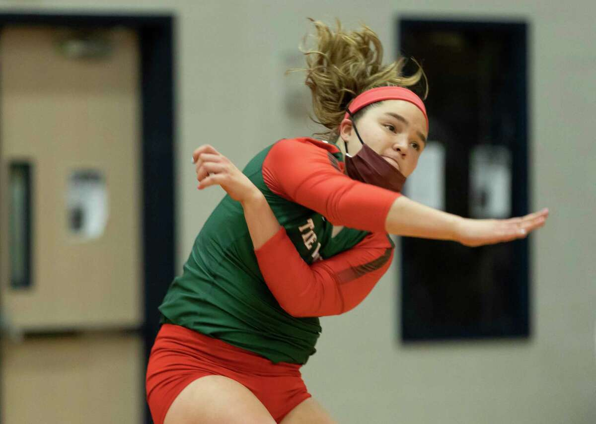 The Woodlands libero Jacqueline Lee (5) serves the ball during the first set of a District 13-6A volleyball match at Oak Ridge High School in Oak Ridge North.