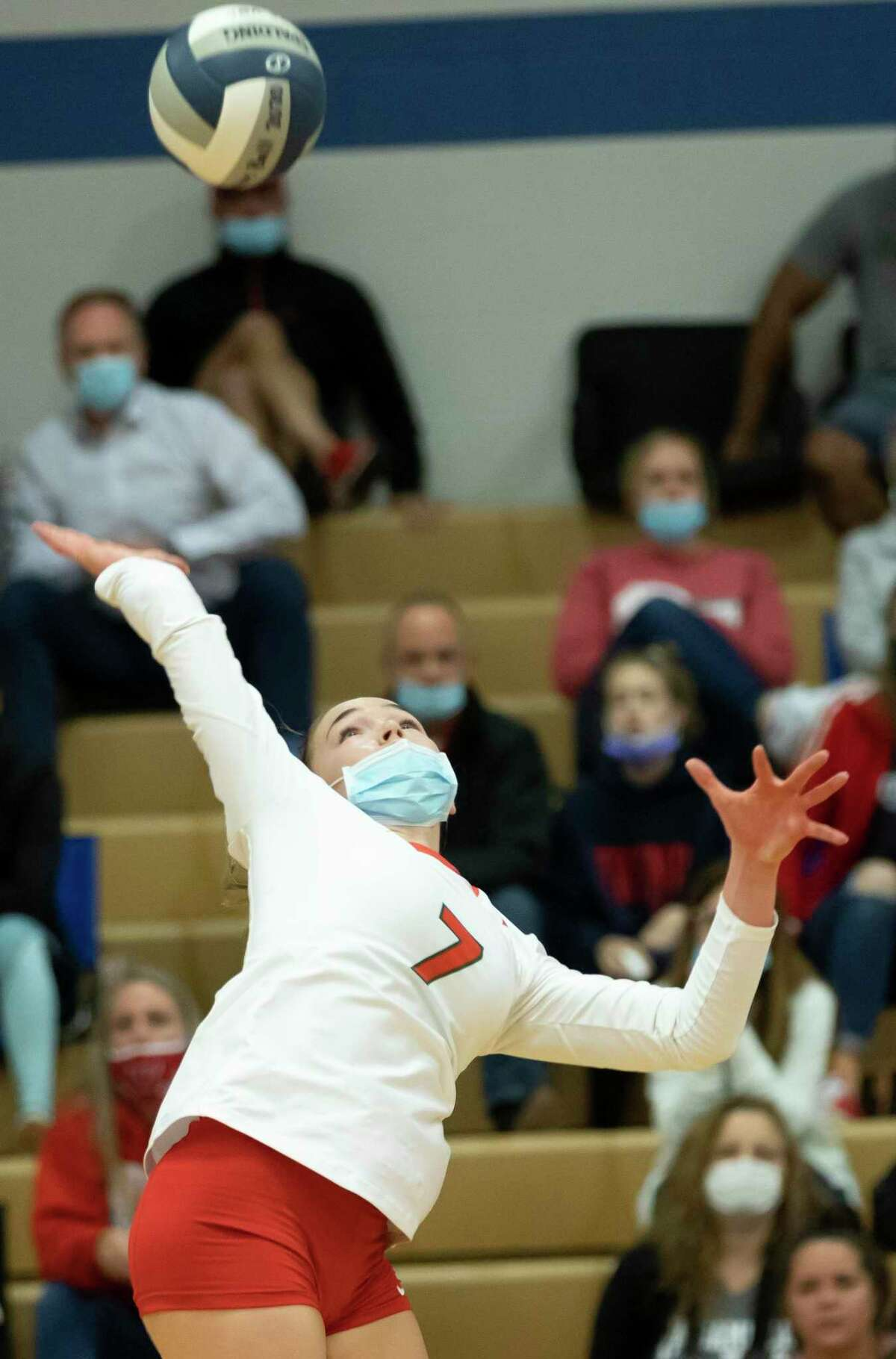 The Woodlands opposite hitter Claire Arend (7) reaches to return a serve during the first set of a District 13-6A volleyball match at Oak Ridge High School in Oak Ridge North.