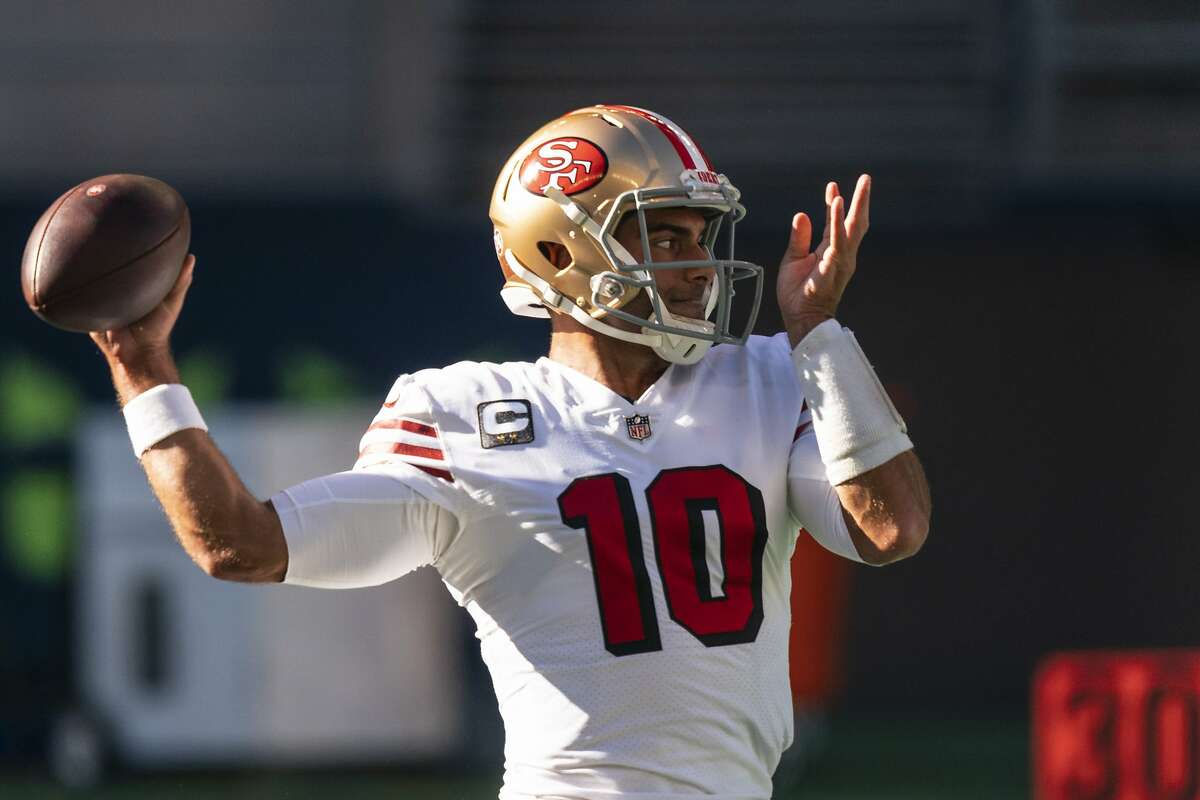San Francisco 49ers quarterback Jimmy Garoppolo looks to pass during warmups before an NFL football game against the Seattle Seahawks, Sunday, Nov. 1, 2020, in Seattle. The Seahawks won 37-27. (AP Photo/Stephen Brashear)