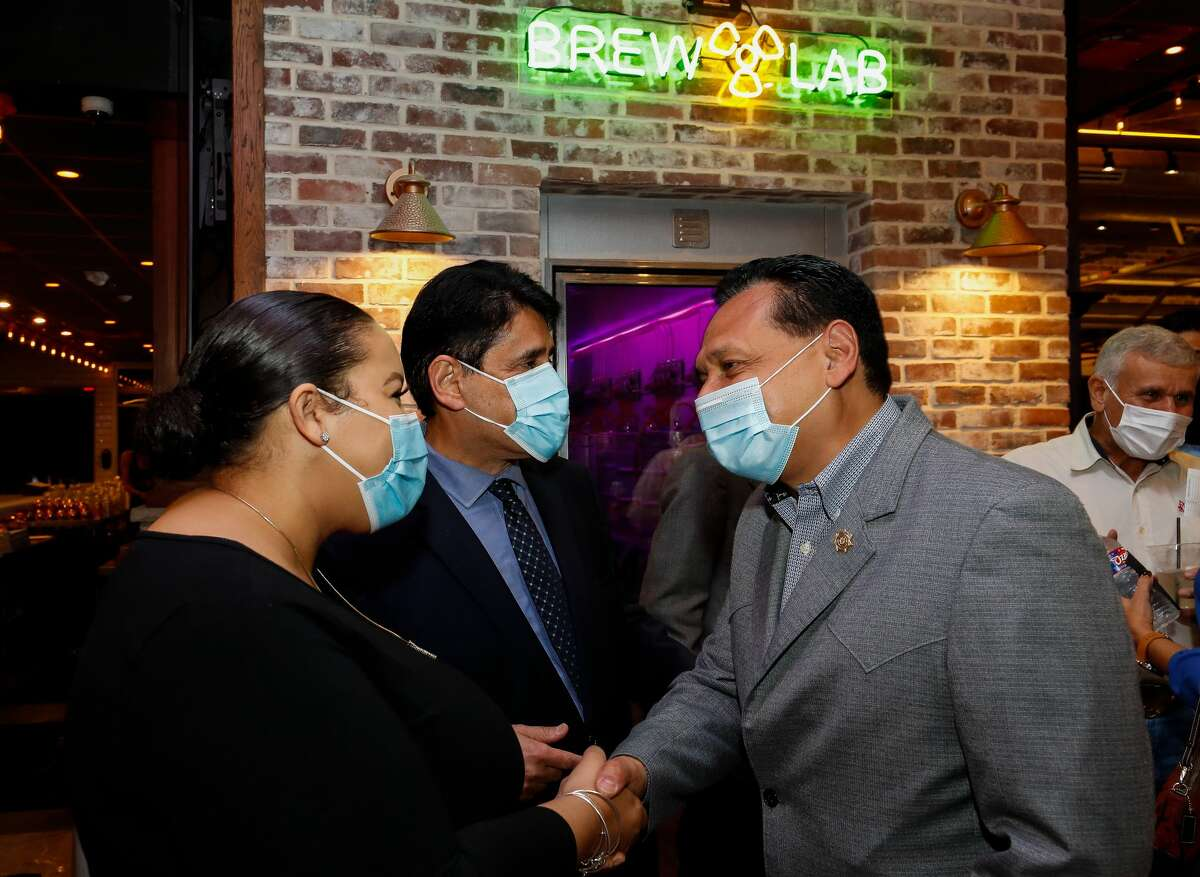 Harris County Sheriff Ed Gonzalez greets people while attending a Democratic watch party at Atomic Bottle on election night Tuesday, Nov. 3, 2020, in Houston.