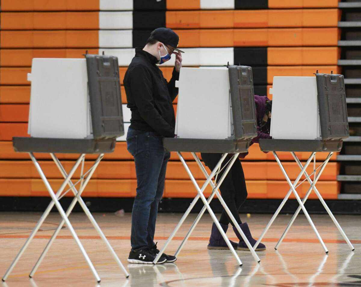 Stamford's George Silano votes on Election Day 2020 at the District 5 polling center at Stamford High School in Stamford, Conn. Tuesday, Nov. 3, 2020.