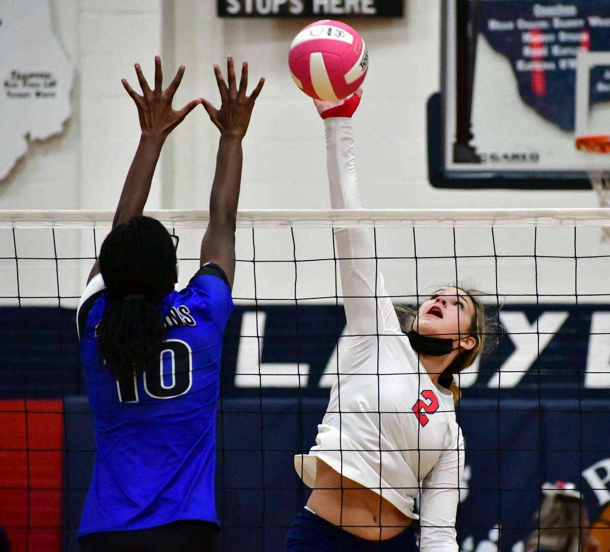 Plainview's Jaycee Louder skies for the ball during a District 3-5A volleyball match against Amarillo Palo Duro on Nov. 3, 2020 in the Dog House at Plainview High School.