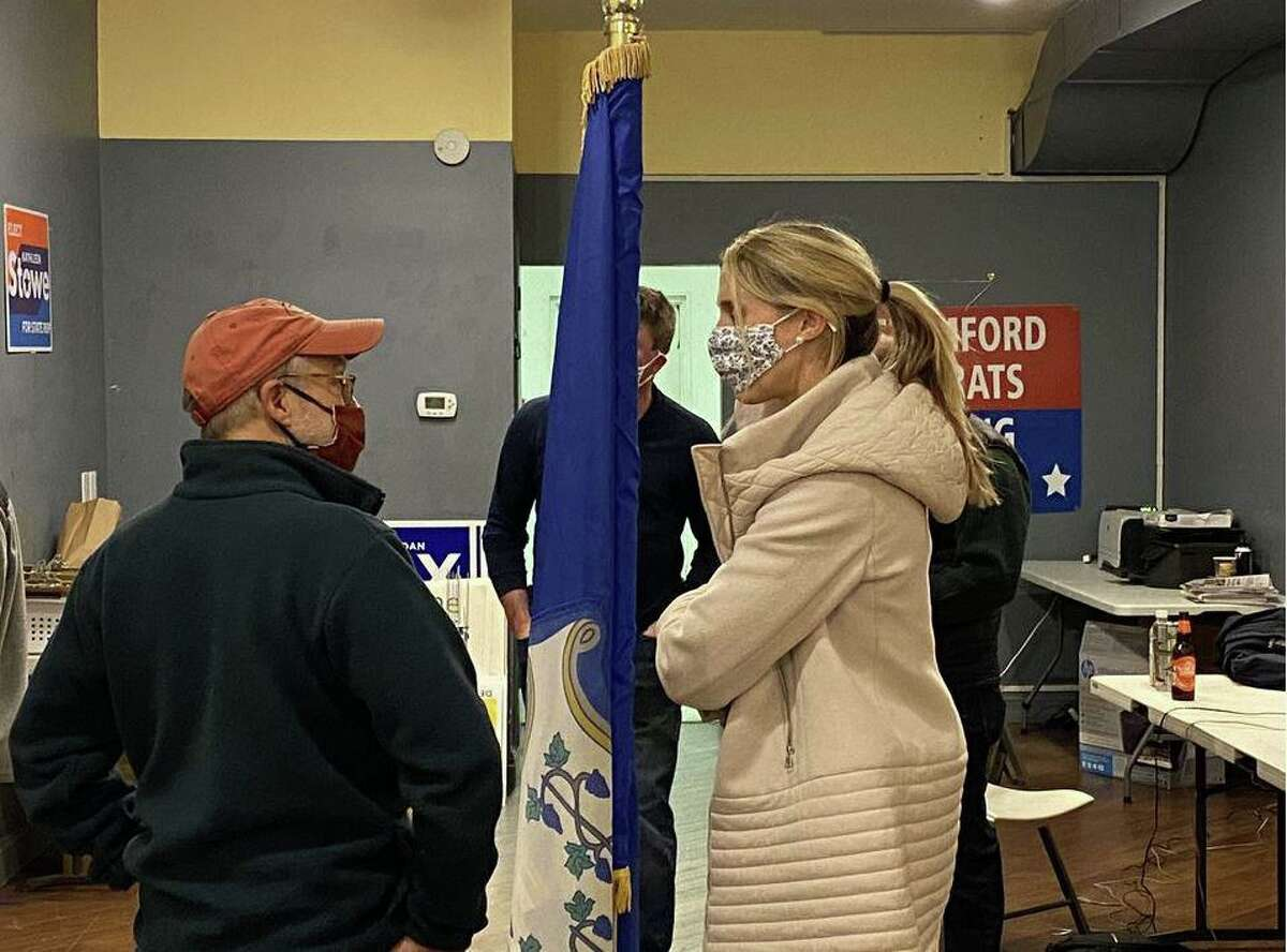State Rep. Caroline Simmons, who ran unopposed for her fourth term in Stamford's 144th House District, arrives at Stamford Democratic headquarters Tuesday night.