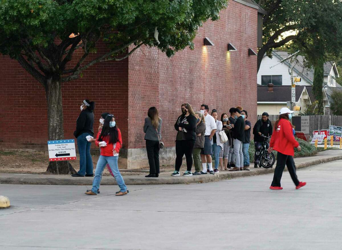 Voters line up at the Henington-Alief Regional Library on Tuesday, Nov. 3, 2020, in Houston.