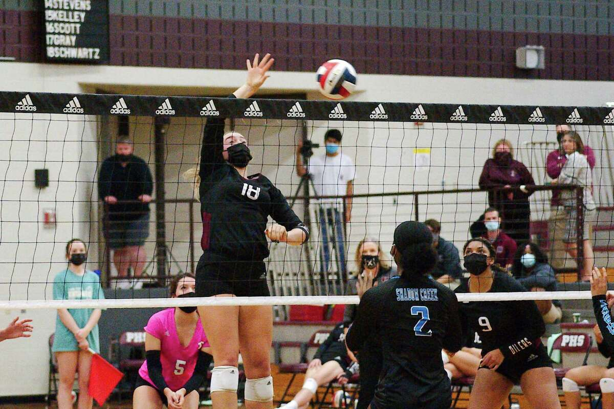 Pearland's Avery Schwartz (18) places a shot over the net against Shadow Creek Tuesday at Pearland High School.