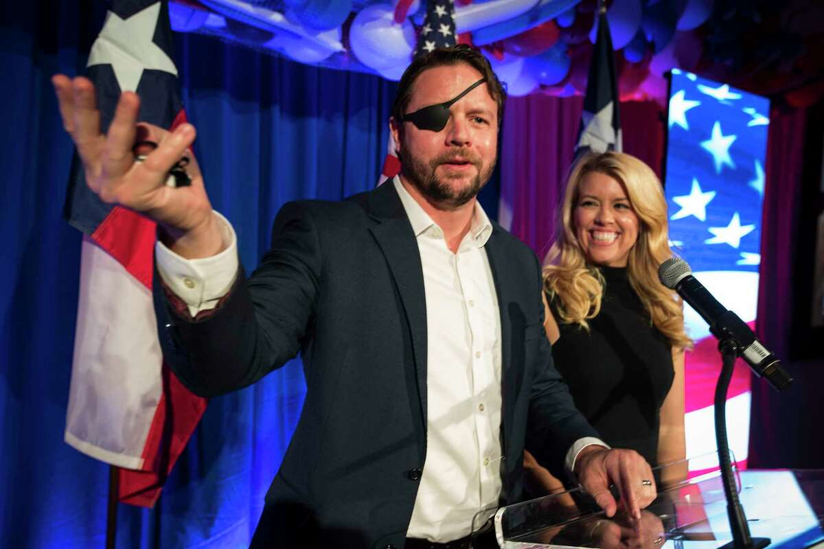 Republican Texas Rep. Dan Crenshaw and his wife, Tara, welcome supporters to an election night watch party in Houston.