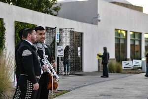 Mariachi Azteca de America plays at the entrance to the polling site at Mission Branch Library on Tuesday.