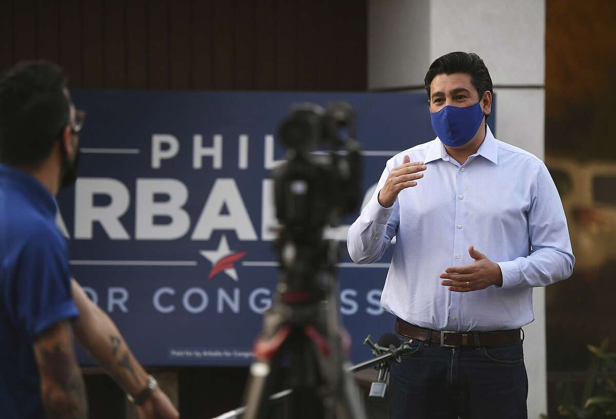 Democrat Phil Arballo, running for U.S. House challenging Devin Nunes for California's 22nd Congressional District, appears for media interviews outside his campaign headquarters on election night Tuesday, Nov. 3, 2020, in Fresno, Calif.