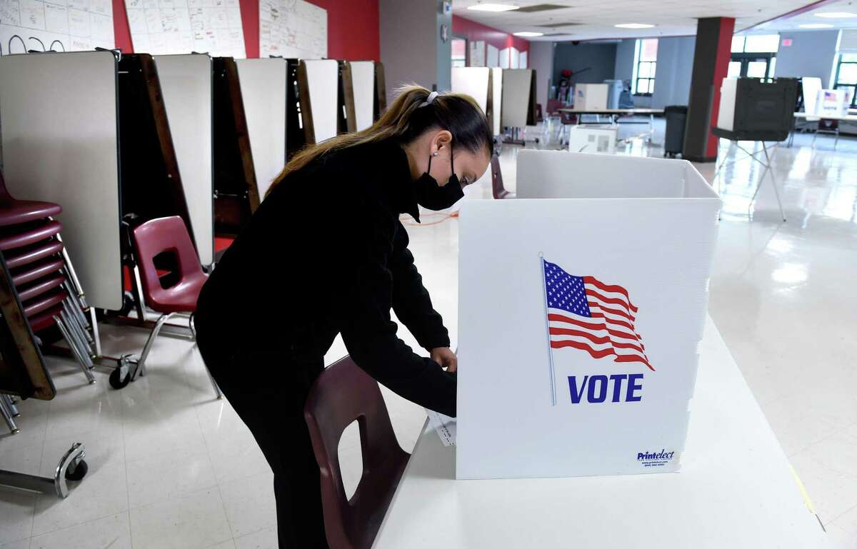 Camila LaBrada votes in the cafeteria of Cheshire High School on November 3, 2020.