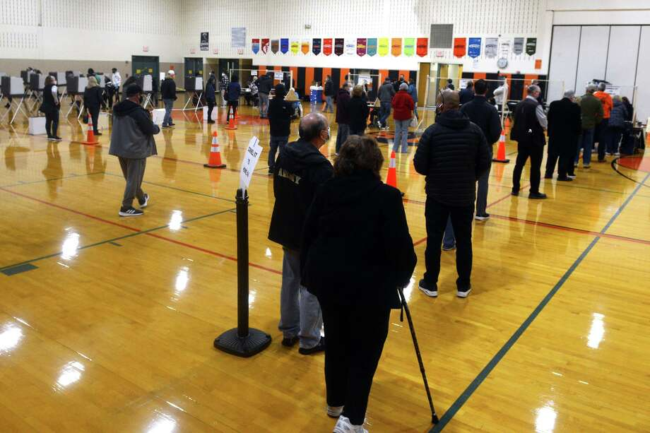 Voters wait in line on Election Day at Shelton Intermediate School, in Shelton, Conn. Nov. 3, 2020. Photo: Ned Gerard / Hearst Connecticut Media / Connecticut Post