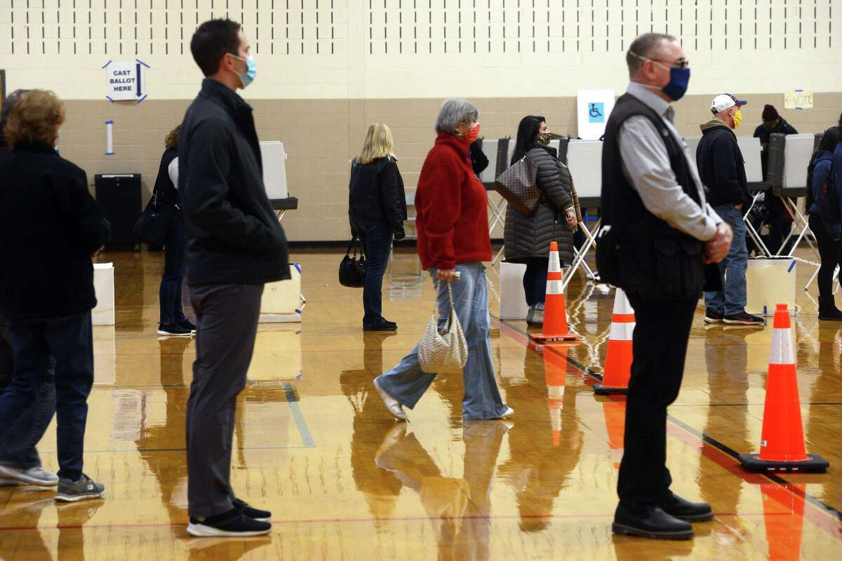 Voters wait in line on Election Day at Shelton Intermediate School.