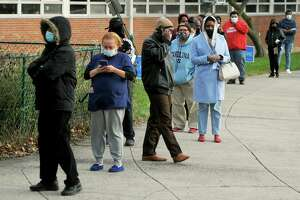 Voters line up on Election Day 2020 outside of Bassick High School, in Bridgeport, Conn. Nov. 3, 2020.