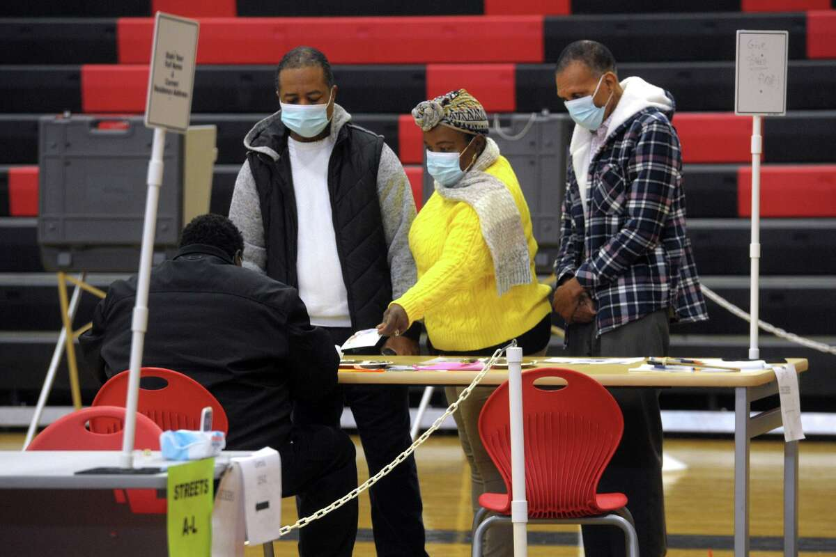 Voters check in to vote on Election Day 2020 at Central High School, in Bridgeport, Conn. Nov. 3, 2020.