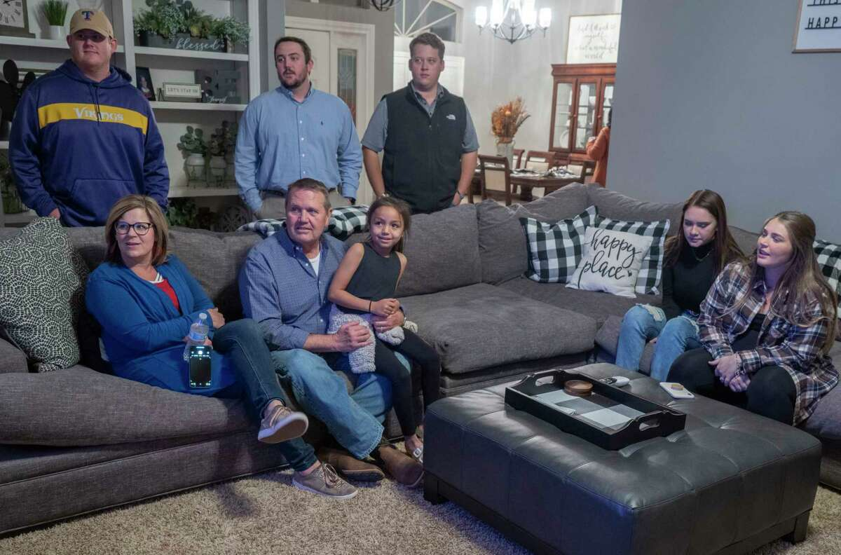Bryan Murry, on couch, MISD District 7 candidate, with his wife Amy and friends daughter, Lola Luna, as well as other family and supporters watch election results 11/03/2020 evening at a watch party at Murry's home. Tim Fischer/Reporter-Telegram