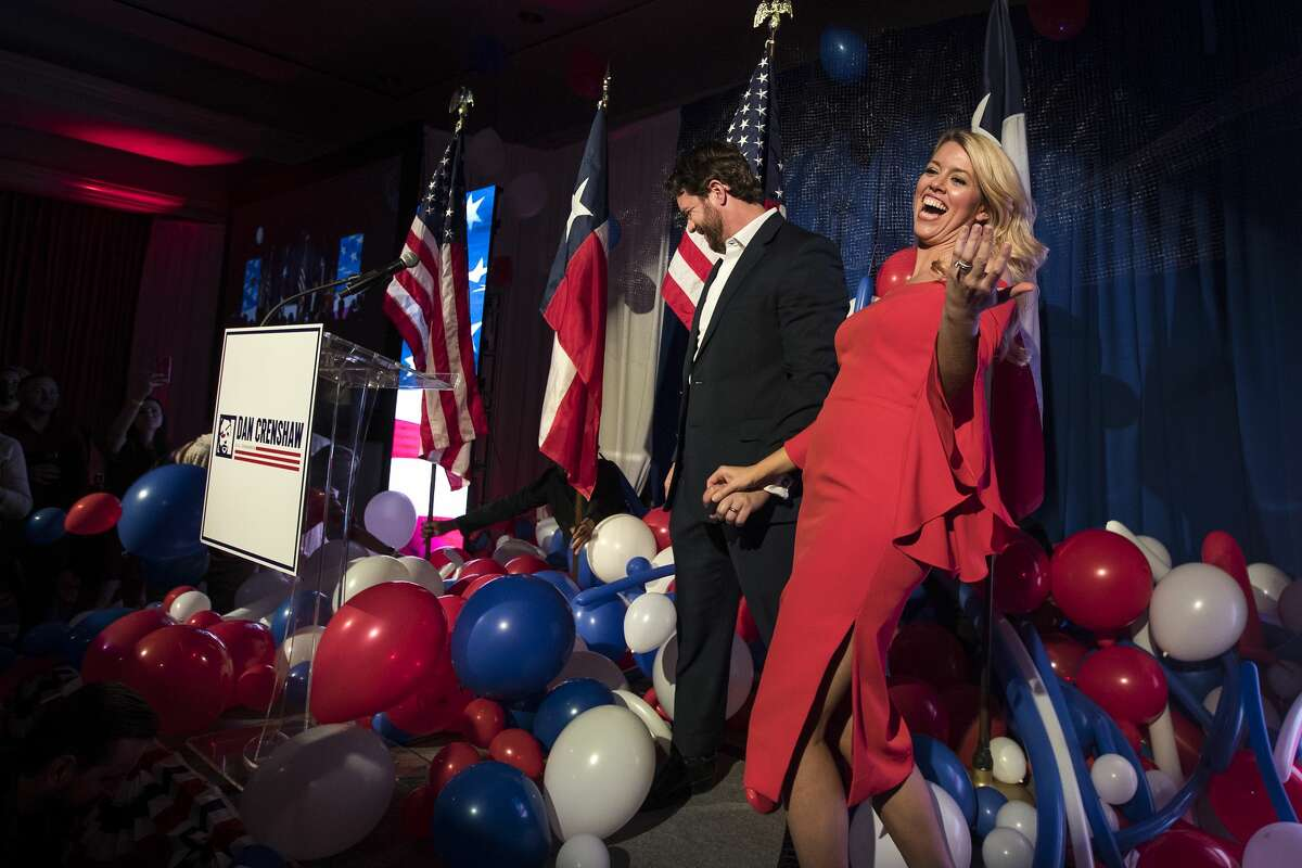 Republican congressman Dan Crenshaw and his wife, Tara, walk off the stage after speaking to his supporters to celebrate his victory during an election watch party Tuesday, Nov. 3, 2020 in Houston.