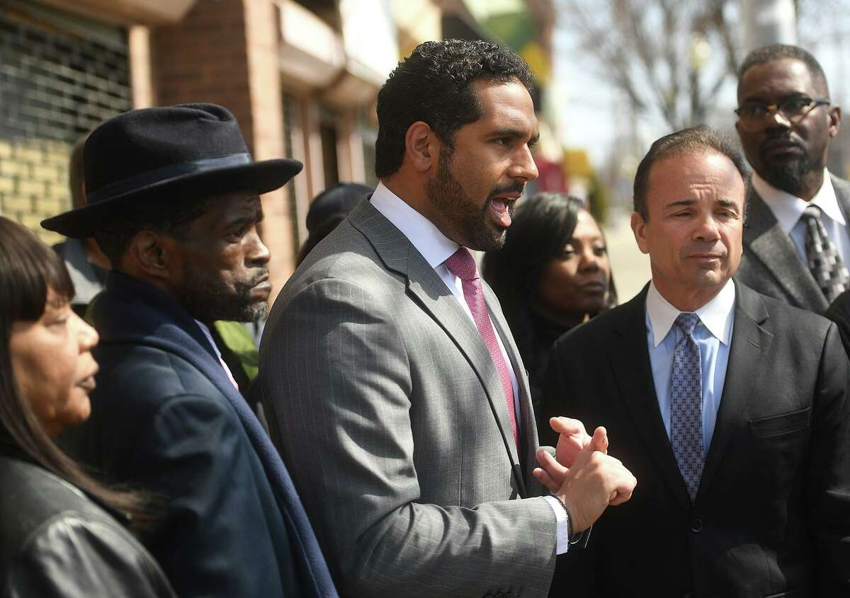 State Senator Dennis Bradley speaks strongly about the need to reopen the old East End police substation at a press conference seeking solutions to Bridgeport's violent crime and gun violence problems outside the former substation at 1149 Stratford Avenue in Bridgeport, Conn. on Thursday, March 28, 2019. Flanking Bradley are City Council member Ernest Newton, left, and Bridgeport Mayor Joe Ganim, right.