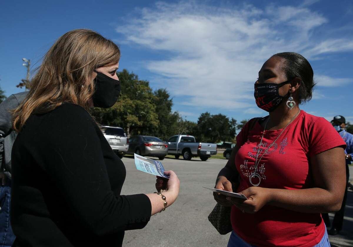 US Congresswoman Lizzie Fletcher greets voter Quienteta Calhoun Tuesday, Nov. 3, 2020, at Bayland Community Center in Houston. Fletcher is seeking for reelection.