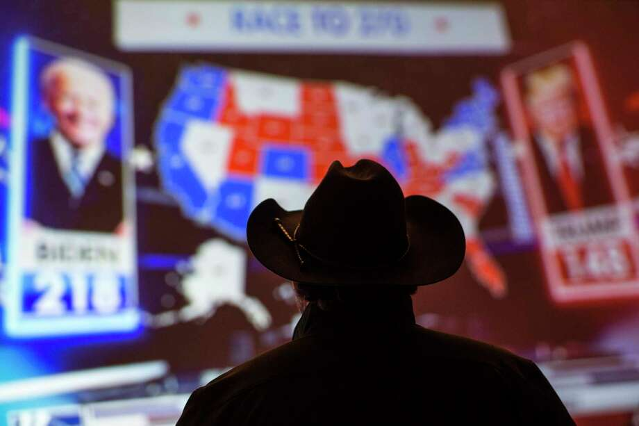 A supporter of Republican congressman Dan Crenshaw watches election returns on a television during an election watch party Tuesday, Nov. 3, 2020 in Houston. Photo: Brett Coomer, Staff Photographer / © 2020 Houston Chronicle