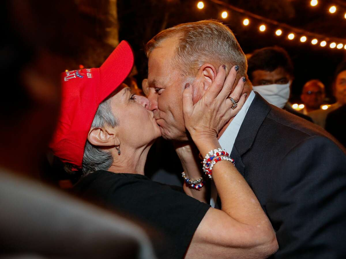 A supporter kisses Troy Nehls, Republican candidate running for congress, during his watch party at Freedom Hall on Tuesday, Nov. 3, 2020, in Richmond, Texas.