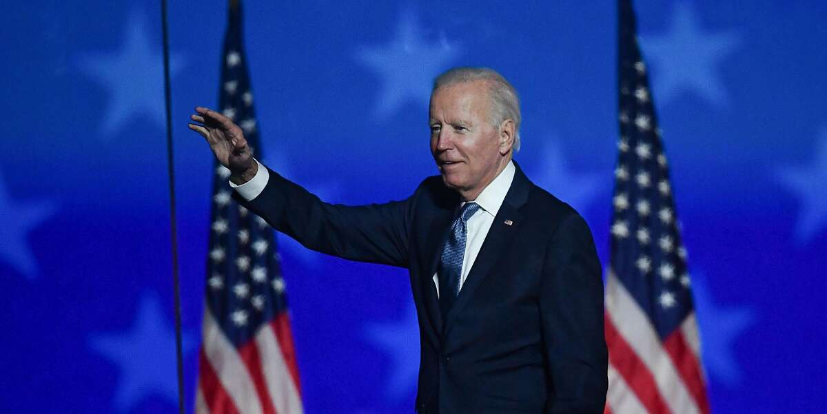 Democratic presidential nominee Joe Biden greets supporters after speaking during election night at the Chase Center in Wilmington, Delaware, early on November 4, 2020. In dueling briefings on Wednesday morning, both campaigns claimed they were on track to win, though the Trump campaign was resting that prediction on allegations of improper ballot counting that ignored local election laws.