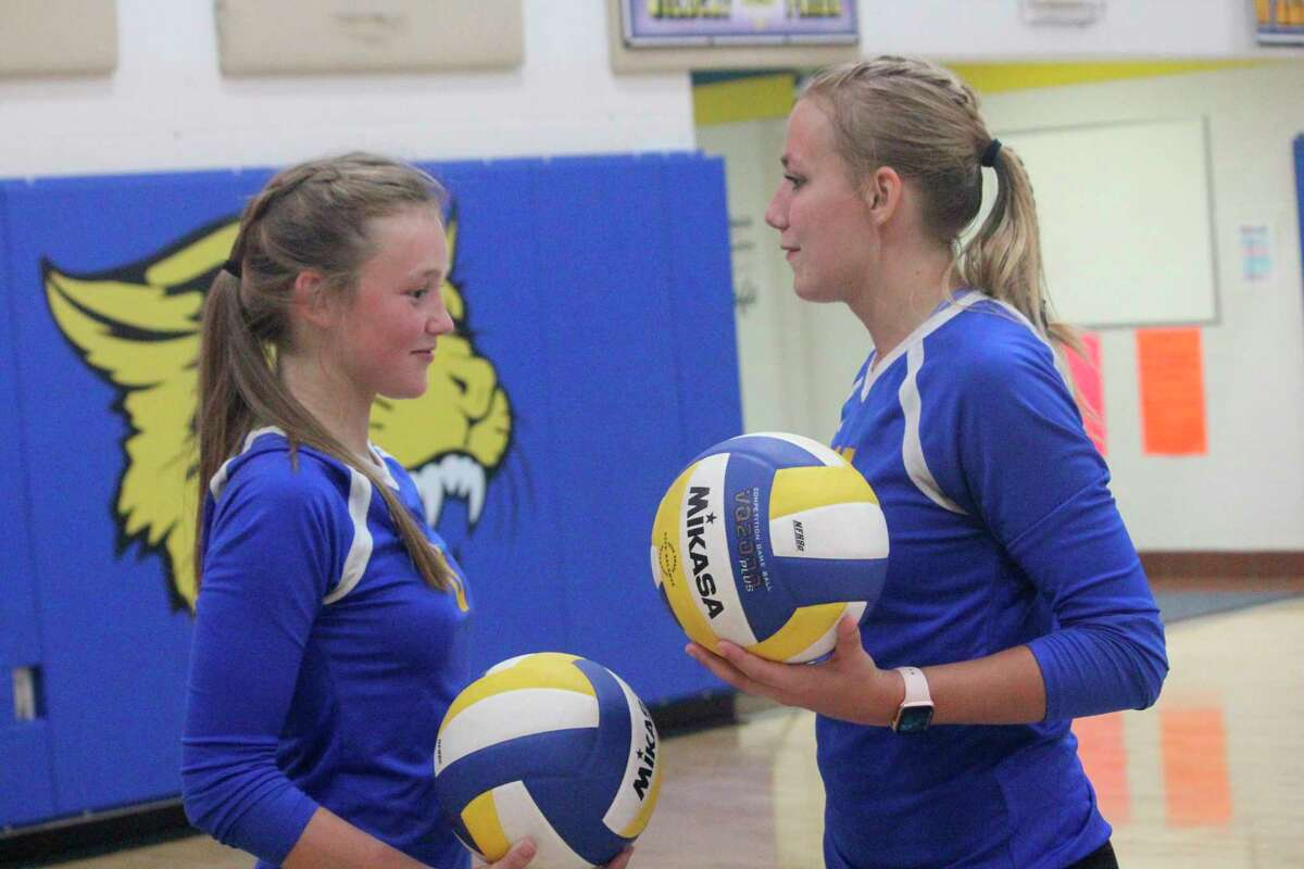 Skylar Baumgardner (left) and Kara Henry have been key players for Evart's volleyball team. (Herald Review photo/John Raffel)