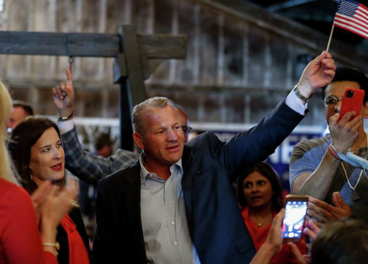 Republican Troy Nehls waves a U.S. flag while celebrating his win the race for congress, during his watch party at Freedom Hall on Tuesday, Nov. 3, 2020, in Richmond, Texas.