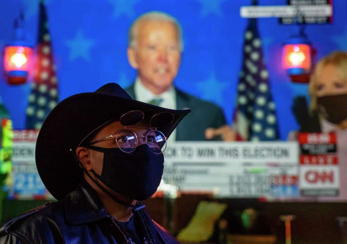 Ray Brackens, who lives in the Third Ward, watches Vice President Joe Biden make a statement on television shortly before midnight local time during a watch party hosted by the GLBT Caucus, Tuesday, Nov. 4, 2020, at Pearl Bar in Houston.