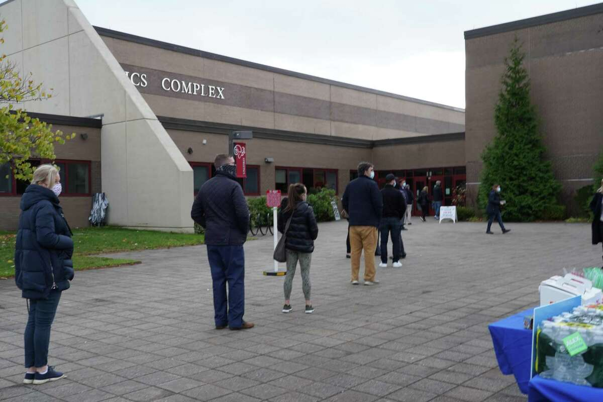 People were lining up to vote in District 1 at New Canaan High School on Tuesday, Nov. 3, 2020. Lines had been longer earlier in the morning.