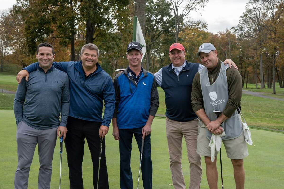 Robert Babkowski, Mark Keough, Chris Riendeaau, and John Cucci took second place in the Circle of Care golf tournament on Oct. 19 at Rolling Hills Country Club.