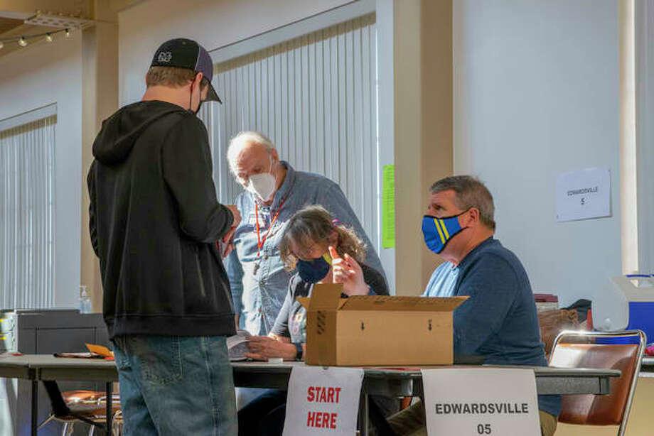 A voter talks with election judges in Lewis and Clark Community College in Edwardsville prior to getting his ballot Tuesday morning. Photo: Tyler Pletsch   Intelligencer
