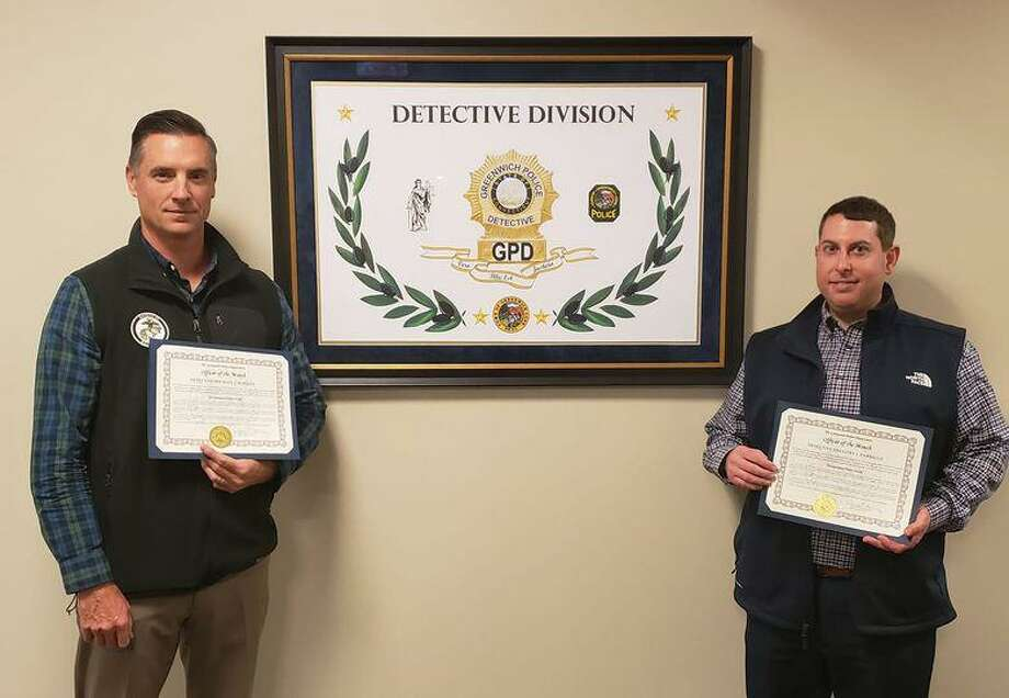 """Detectives Michael Rooney, left, and Gregory Parrillo were cited as """"Officers of the Month"""" in November. Photo: Contributed / Greenwich Police Department"""