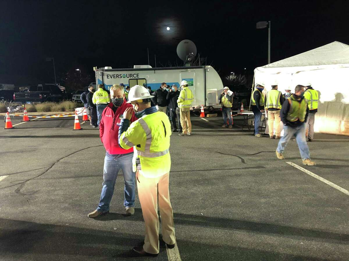Derby Mayor Richard Dziekan speaks to Eversource crews at a staging area in the Lowe's parking lot in Derby on Tuesday evening.