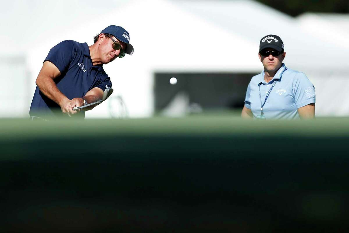 Phil Mickelson chips on the practice range during the Pro-Am at the Vivint Houston Open at Memorial Park Golf Course on Wednesday, November 4, 2020.