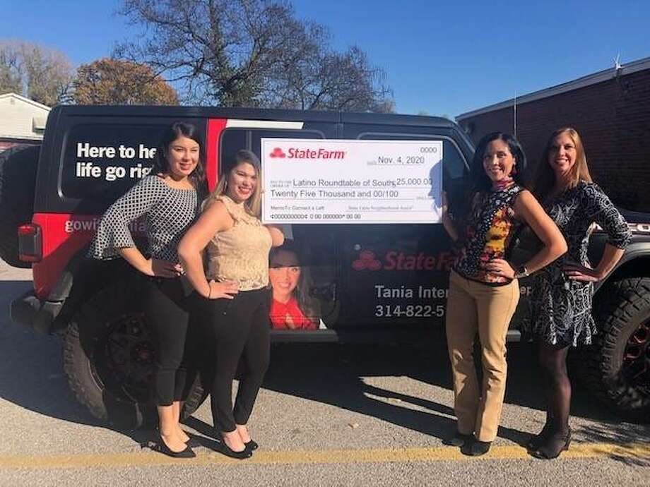 State Farm agent Tania Interian displays the winning $25,000 Neighborhood Assist grant check that will provide three years of free internet to Fairmont City residents. Pictured from left are Candy Sanchez, Nancy Rodriguez, Interian and Stacy Farinella.