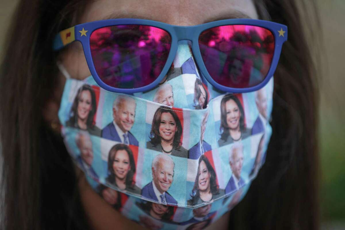 Mauri Lucas wears a Biden-Harris mask at a press conference in front of the Harris County Clerk's Office Wednesday, Nov. 4, 2020, in Houston.