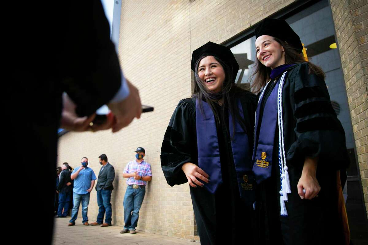 Graduates pose for a picture during a weekend of commencement ceremonies for the South Texas College of Law Houston on Saturday, Oct. 17, 2020. The school celebrated with 13 commencement ceremonies over two days to honor COVID-19 graduates.