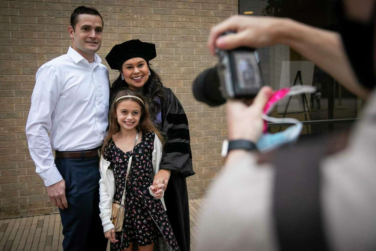 Matthew, Ashley and Blakely Reilly pose for a picture during a full day of commencement ceremonies for the South Texas College of Law Houston on Saturday, Oct. 17, 2020. The school celebrated with 13 commencement ceremonies over two days to honor COVID-19 graduates.