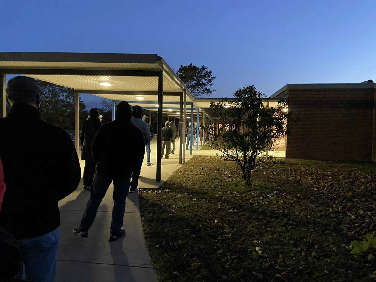 Voters line up outside Madison Middle School before the polls open at 6 a.m. on Tuesday.