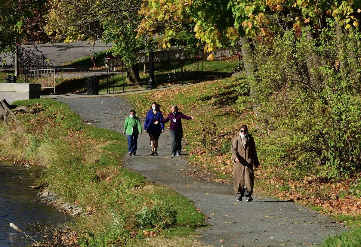 People are seen enjoying a seasonably mild day by walking in Washington Park on Wednesday, Nov. 4, 2020 in Albany, N.Y. (Lori Van Buren/Times Union)