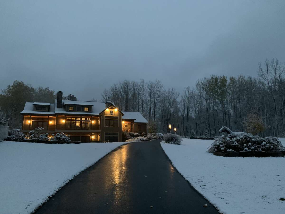 Scott Rajeski offers this atmospheric image of the Saratoga Lake family's home and yard in the early morning as the snow falls.