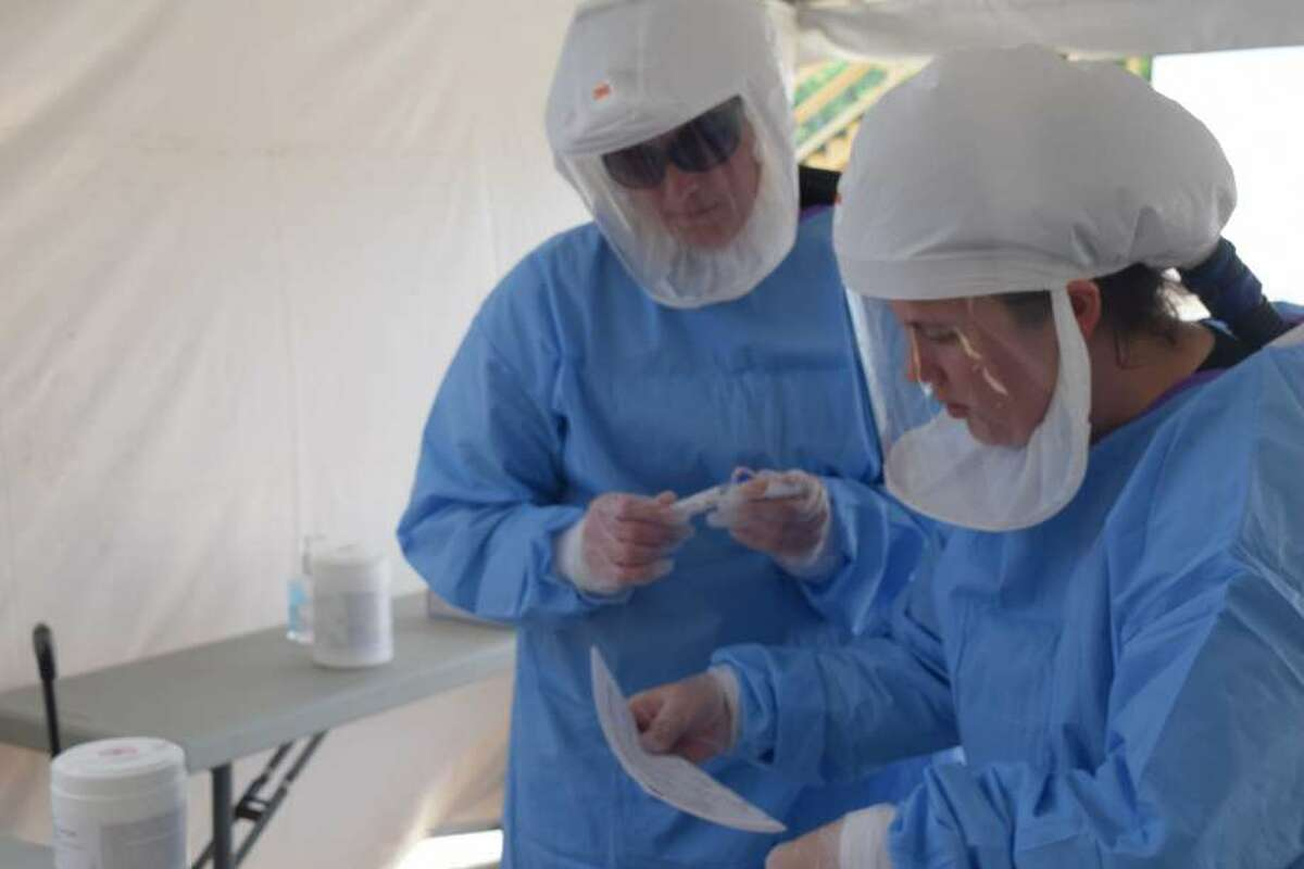 Morgan County Health Department employees prepare for COVID-19 testing at a drive-up site.