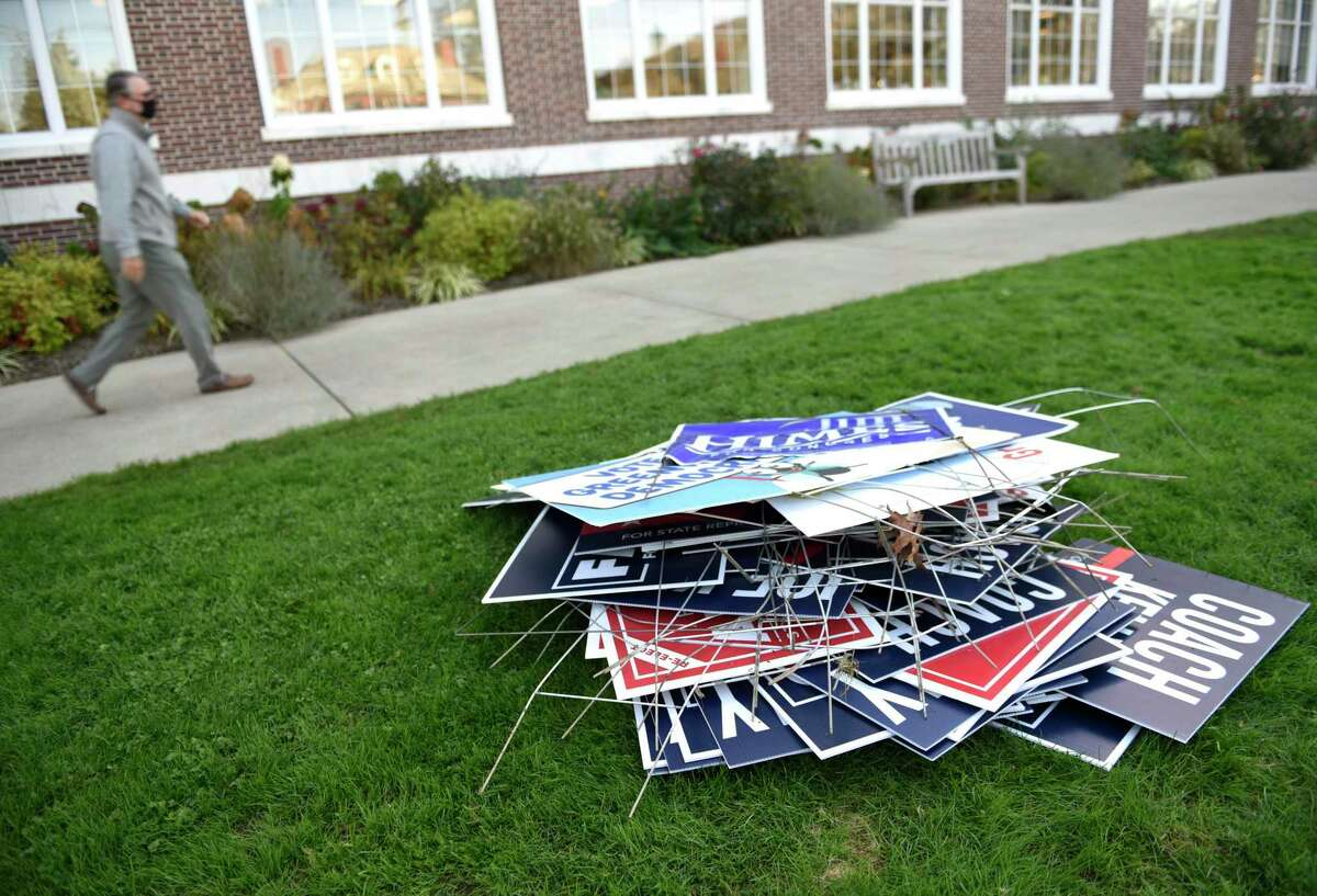 A pile of political signs are taken down outside Town Hall in Greenwichon the day after Election Day .