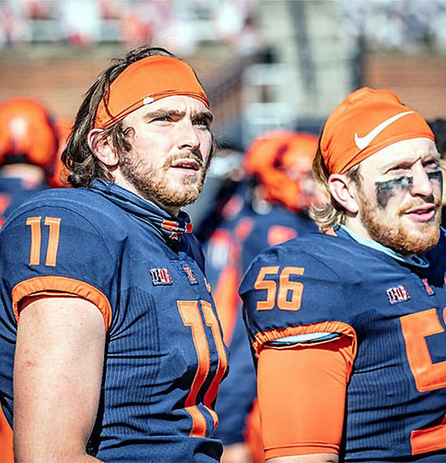 Illinois placekicker Caleb Griffin (11) and long snapper Ethan Tabel watch from the sideline during Saturday's game against Purdue at Memorial Stadium in Champaign. Photo: Michael Glasgow | Illinois Athletics