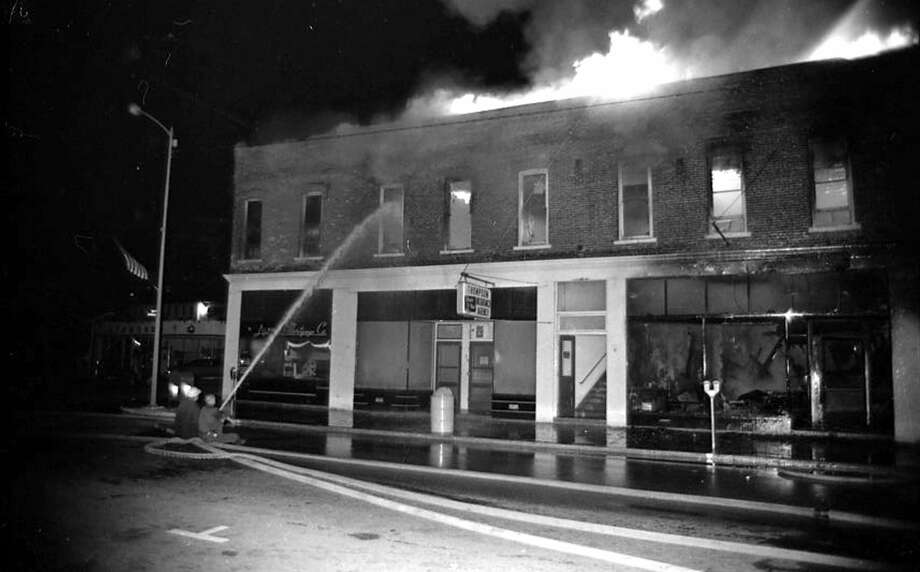 In 1971 a fire destroyed the buildings on the corner River and Division streets.(Manistee County Historical Museum photo) Photo: Manistee County Historical Museum