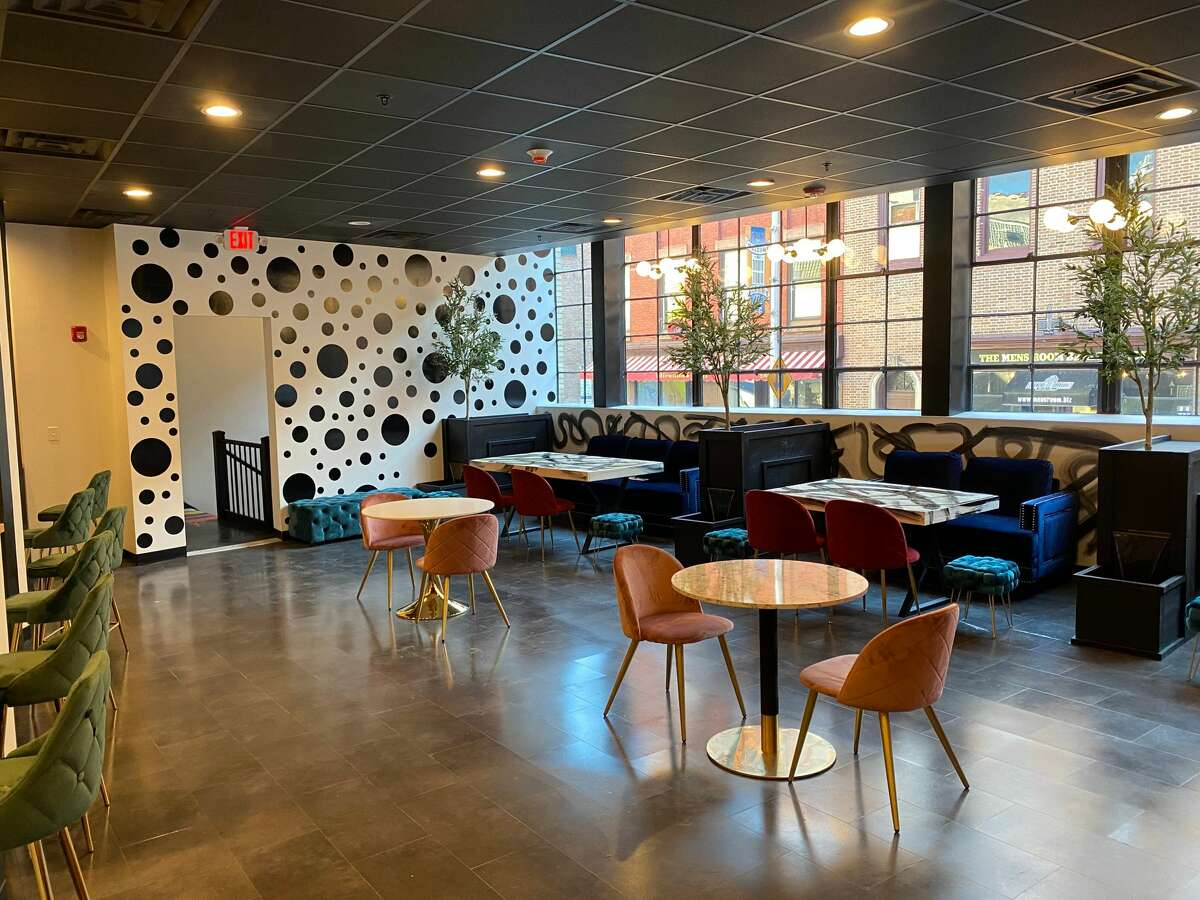 Tables with couches, chairs and stools run beneath windows facing Columbia Street at The Cloud Food Hall in downtown Albany. Opening Nov. 10 and offering ordering from six menu concepts only via the restaurant's app, for takeout, delivery and limited dine-in space, The Cloud Food Hall is the evolution of a multimenu food court started at Troy Kitchen in Troy. (Steve Barnes/Times Union.)