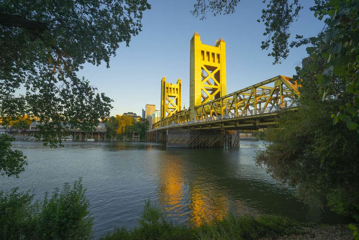 The Tower Bridge is reflected in the Sacramento River.