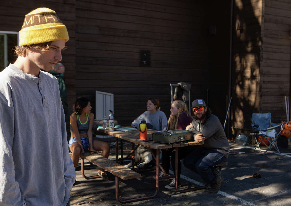 Evan Olson and a group of residents at the Cisco Grove Campground ponder what to do next after a fire threatened the future of their housing at Cisco Grove.