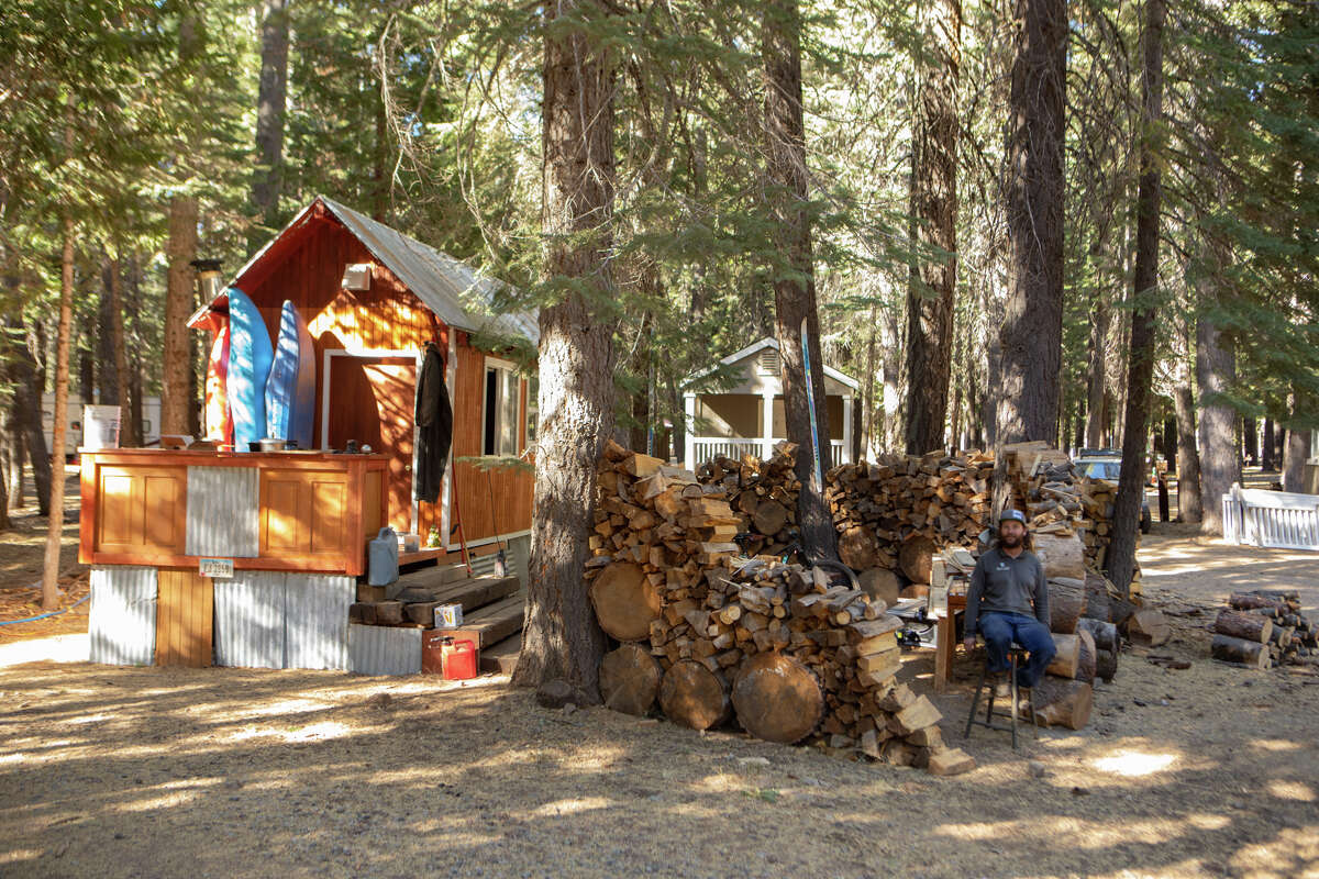 A Cisco Grove resident outside his recently built tiny home in the campground.